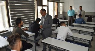 The President of the University of Kufa inspects the progress of the third round examinations in the Faculty of Science